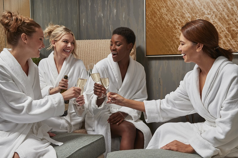 Lifestyle Photography shot for Maryland Live Casino & Resort. Group of women having Spa Party sitting in locker room wearing robes and drinking champagne.